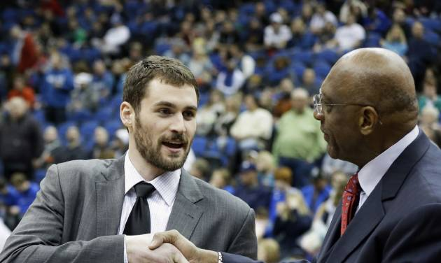 Minnesota Timberwolves' Kevin Love receives the Kia Community Assist Award from former NBA basketball player Bob Lanier, right, in recognition of his efforts in the community including his ongoing work with the Kevin Love Coat Drive prior to the Timberwolves hosting the Golden State Warriors in an NBA basketball game Sunday, Feb. 24, 2013, in Minneapolis. Love has been out with a broken hand. (AP Photo/Jim Mone)