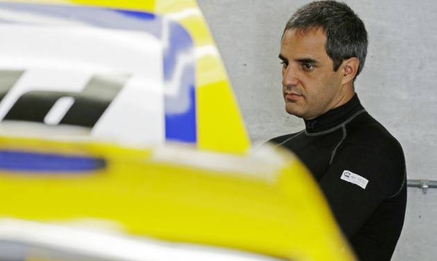 Driver Juan Pablo Montoya waits as the crew works on his car before practice for the Brickyard 400 Sprint Cup series auto race at the Indianapolis Motor Speedway in Indianapolis, Friday, July 25, 2014. (AP Photo/Darron Cummings)