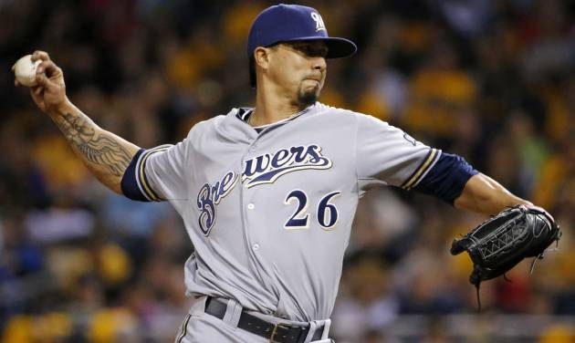 Milwaukee Brewers starting pitcher Kyle Lohse winds up during the fourth inning of a baseball game against the Pittsburgh Pirates in Pittsburgh on Friday, April 18, 2014. (AP Photo/Gene J. Puskar)