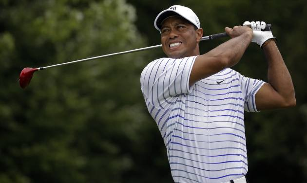 Tiger Woods winces after tee shot on the sixth hole during the second round of the PGA Championship golf tournament at Valhalla Golf Club on Friday, Aug. 8, 2014, in Louisville, Ky. (AP Photo/Jeff Roberson)