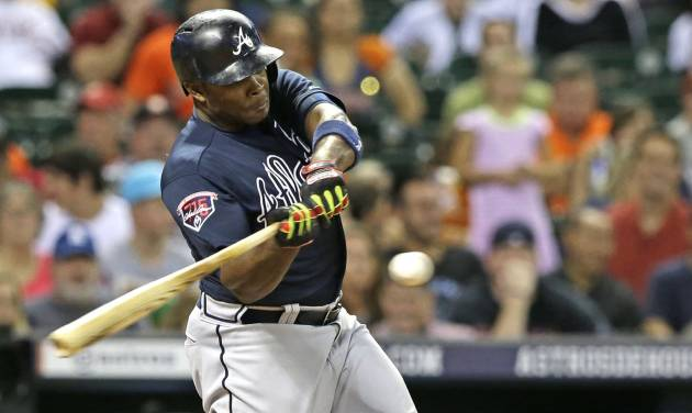 Atlanta Braves' Justin Upton hits a two-run homer against the Houston Astros in the seventh inning of a baseball game Wednesday, June 25, 2014, in Houston. (AP Photo/Pat Sullivan)