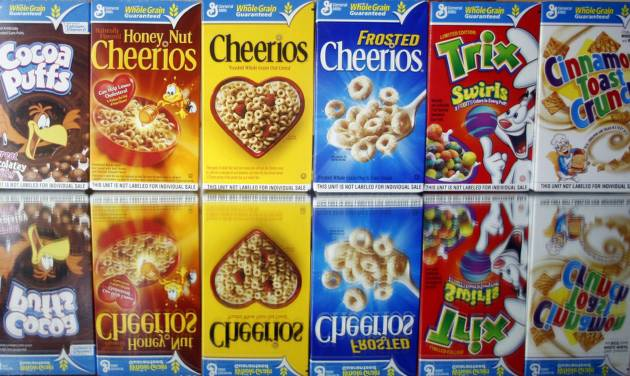 FILE - This March 22, 2011 file photo shows boxes of General Mills cereals in Portland, Ore. The Minneapolis-based company, which last month announced a cost-cutting plan that will include a review of its manufacturing plants, is working to adapt its offerings as it grapples with the changing eating habits of Americans. (AP Photo/Rick Bowmer, File)