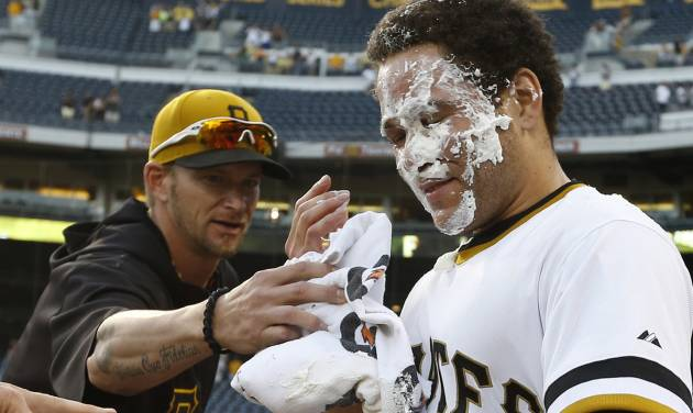 Pittsburgh Pirates' Russell Martin (55) gets a face full of cream from a towel in celebration from Pittsburgh Pirates'  A.J. Burnett after Martin drove in Gaby Sanchez with the game-winning hit in the 14th inning of the baseball game against the Milwaukee Brewers on Sunday, June 30, 2013, in Pittsburgh. The Pirates won 2-1 in 14 innings. (AP Photo/Keith Srakocic)
