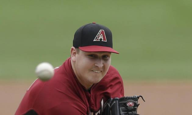 Arizona Diamondbacks starting pitcher Trevor Cahill pitches to an Oakland Athletics batter during the first inning of an exhibition spring training baseball game Thursday, March 6, 2014, in Scottsdale, Ariz. (AP Photo/Gregory Bull)