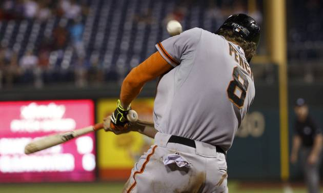 San Francisco Giants' Hunter Pence doubles down the right field line to score three runs and reach third base on a throwing error during the ninth inning of a baseball game against the Philadelphia Phillies, Wednesday, July 23, 2014, in Philadelphia. The Giants won 3-1. (AP Photo/Chris Szagola)