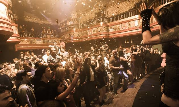 In this image provided by The Act nightclub, patrons enjoy a perfromance at the club located at the Palazzo hotel-casino on the Las Vegas Strip. The Palazzo  is trying to terminate their 10-year agreement with the nightclub after 10 months of operation. They say the shows at the venue inside the Palazzo are so raunchy they violate obscenity laws. (AP Photo/The Act Nightclub, Denise Truscello )