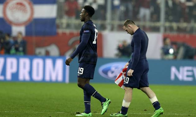 Manchester United's Wayne Rooney, right, and Danny Welbeck leave the pitch after Champions League, round of 16, first leg soccer match against Olympiakos at Georgios Karaiskakis stadium, in Piraeus port, near Athens, on Tuesday, Feb. 25, 2014. Olympiakos won 2-0. (AP Photo/Thanassis Stavrakis)