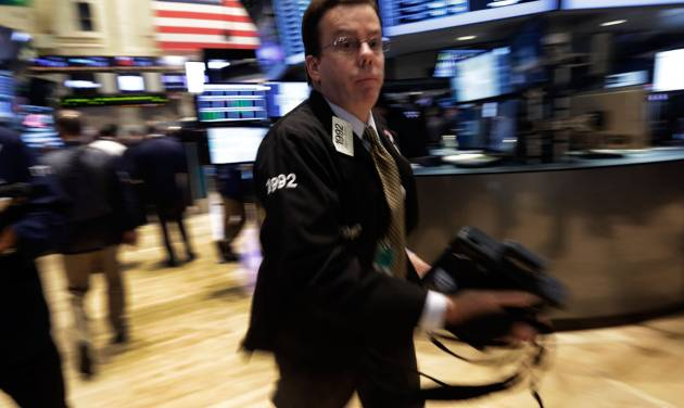 Trader Joseph Murray rushes across the floor of the New York Stock Exchange Wednesday, Oct. 9, 2013. Stocks are wavering between small gains and losses in early trading as US companies report mixed earnings news. (AP Photo/Richard Drew)