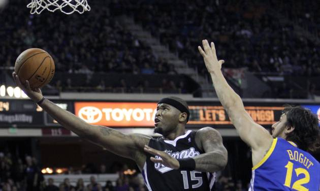 Sacramento Kings center DeMarcus Cousins, center, drives to the basket between Golden State Warriors' Klay Thompson, left, and Andrew Bogut, of Australia, during the second half of an NBA basketball game in Sacramento, Calif., Monday, Nov. 5, 2012. The Kings won 94-92.(AP Photo/Rich Pedroncelli)