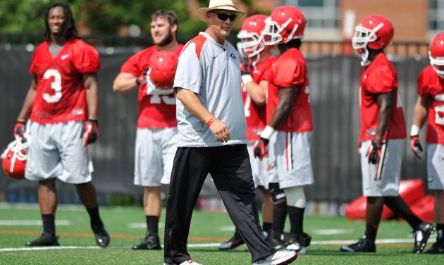 CORRECTS NAME OF PHOTOGRAPHER IN CAPTION - Georgia coach Mark Richt watches his players during NCAA college football practice Friday, Aug. 1, 2014, in Athens, Ga. (AP Photo/Athens Banner-Herald, AJ Reynolds)