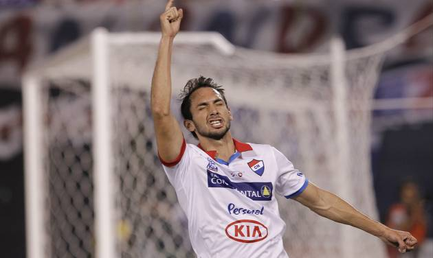 Julio Santa Cruz of Paraguay's Nacional celebrates after scoring against Argentina's San Lorenzo during the first leg of the Copa Libertadores soccer final in Asuncion, Paraguay, Wednesday, Aug. 6, 2014. The game ended in a 1-1 tie. (AP Photo/Cesar Olmedo)