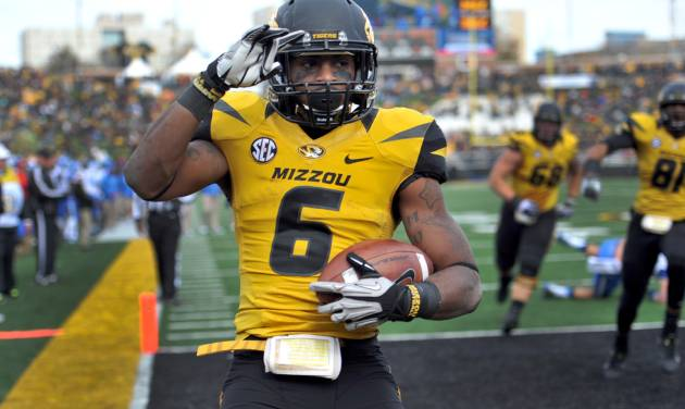 Missouri running back Marcus Murphy celebrates after scoring on a nine-yard touchdown run during the second half of an NCAA college football game against Kentucky Saturday, Oct. 27, 2012, in Columbia, Mo. Missouri won 33-10. (AP Photo/L.G. Patterson)