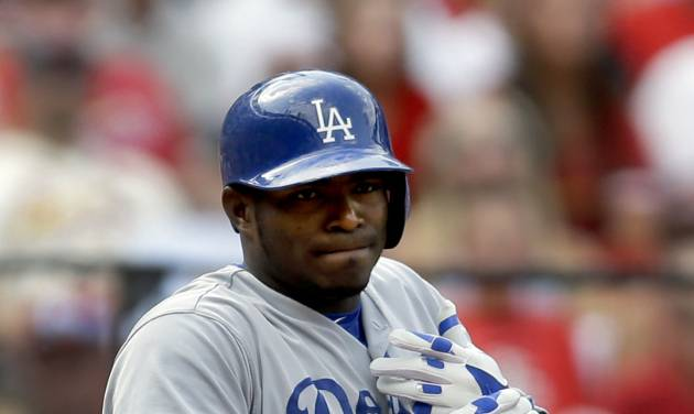 Los Angeles Dodgers' Yasiel Puig holds his left hand after he was hit by a pitch during the third inning of a baseball game against the St. Louis Cardinals Saturday, July 19, 2014, in St. Louis. Puig left the game in the eighth inning and the Cardinals went on to win 4-2. (AP Photo/Jeff Roberson)