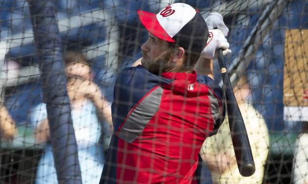 Washington Nationals outfielder Bryce Harper takes batting practice before the start of a baseball game against the Colorado Rockies at Nationals Park, on Monday, June 30, 2014, in Washington. The Nationals have reinstated Harper from the 15-day disabled list after the star outfielder missed 59 games because of a torn ligament in his left thumb. (AP Photo/ Evan Vucci)