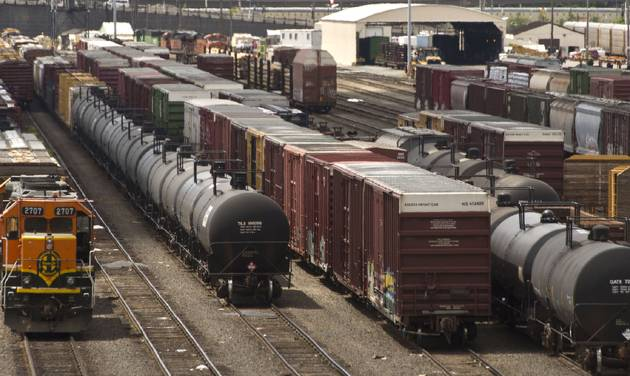 FILE -- In this June 20, 2013 file photo, black tank cars used to transport crude oil from North Dakota are parked among other rail traffic at a train yard in Tacoma, Wash. Washington lawmakers on Monday, Feb. 10, 2014, are considering competing measures that try to address safety issues surrounding the increased number of crude oil trains moving throughout the state. The Senate Ways and Means Committee is taking testimony on a mostly Republican-backed bill. Meanwhile, the House Appropriations Committee is hearing another measure, favored by environmentalists. (AP Photo/Tacoma News Tribune, Lui Kit Wong, File)