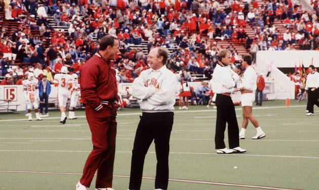 University of Oklahoma (OU) college football coach Barry Switzer and Oklahoma State University (OSU) football coach Pat Jones visit on the field before the 11/7/87 Sooner-Cowboy contest in Norman.  The Sooners prevailed, 29-10. Staff photo by Doug Hoke taken 11/7/87; photo ran in the 11/5/88 Daily Oklahoman.