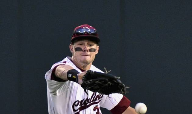 South Carolina's Evan Marzilli fails to catch a fly ball hit for a double by Arkansas' Tim Carver in the third inning of an NCAA College World Series baseball elimination game in Omaha, Neb., Friday, June 22, 2012. The winner advances to play Arizona in the championship series. (AP Photo/Ted Kirk)