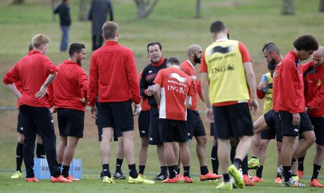Belgium's head coach Marc Wilmots, center, talks with his players during a training session of Belgium in Mogi Das Cruzes, Brazil, Thursday, June 19, 2014. Belgium play in group H of the 2014 soccer World Cup. (AP Photo/Andrew Medichini)