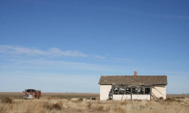 This December 2013 photo shows an abandoned building and car in rural Cimarron County in the Oklahoma Panhandle. Before becoming a part of Oklahoma Territory, this strip known as No Man's Land was a haven for outlaws and land squatters. Later, during the Great Depression, severe drought and blinding dust storms turned the region into the Dust Bowl. The strong survived, and today the Panhandle of Oklahoma is made up of dedicated ranchers, a growing Hispanic population and awe-inspiring views of rural life at its finest. (AP Photo/Kristi Eaton)