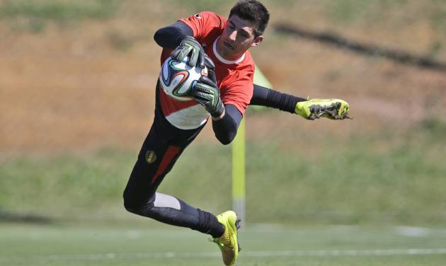 Belgium's goalkeeper Thibaut Courtois jumps to catch the ball during a team training session in Mogi Das Cruzes, Brazil, Friday, June 13, 2014. Belgium play in group H of the 2014 soccer World Cup. (AP Photo/Andrew Medichini)
