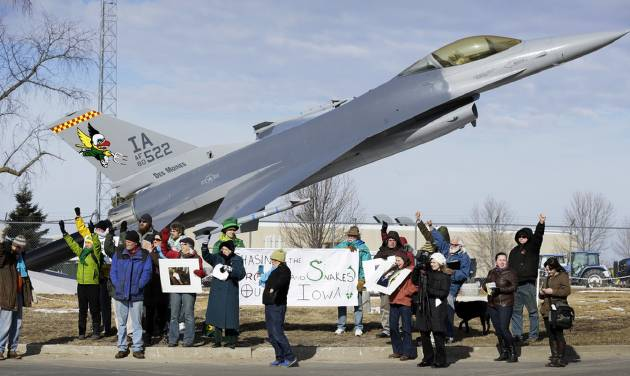 "FILE - In this March 17, 2014 file photo protesters rally outside the Iowa Air National Guard base, in Des Moines, Iowa. Seven protesters, who were rallying against the use of drones to carry out military strikes, were arrested at the base. Diplomats in Geneva, Switzerland on Tuesday, May 13, 2014 began discussing for the first time at the United Nations whether new international laws are needed to govern the use of ""killer robots"" _ so-called lethal autonomous weapons systems that could go beyond human-directed drones _ if emerging technologies make their development possible. (AP Photo/Charlie Neibergall, File)"