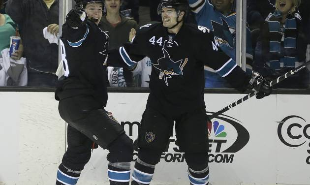 San Jose Sharks' Marc-Edouard Vlasic (44) celebrates with Joe Pavelski, left, after Vlasic scored against the Los Angeles Kings during the second period of Game 1 of an NHL hockey first-round playoff series Thursday, April 17, 2014, in San Jose, Calif. (AP Photo/Ben Margot)