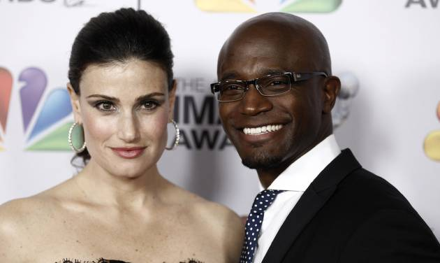 "FILE - This Feb. 17, 2012 file photo shows Idina Menzel, left, and Taye Diggs at the 43rd NAACP Image Awards in Los Angeles. A publicist for the couple announced their breakup Thursday, Dec. 12, 2013 in a statement that said the separation was ""jointly decided"" and that ""primary focus and concern is for their son.""(AP Photo/Matt Sayles, File)"