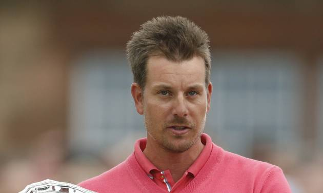 Runner up Henrik Stenson of Sweden holds his trophy after the British Open Golf Championship at Muirfield, Scotland, Sunday July 21, 2013. (AP Photo/Peter Morrison)