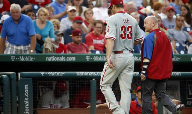 Philadelphia Phillies starting pitcher Cliff Lee (33) walks to the dugout during the third inning of a baseball game against the Washington Nationals at Nationals Park Thursday, July 31, 2014, in Washington. The Phillies announced that Lee had a recurrence of the left flexor pronator strain that sidelined him in May. (AP Photo/Alex Brandon)