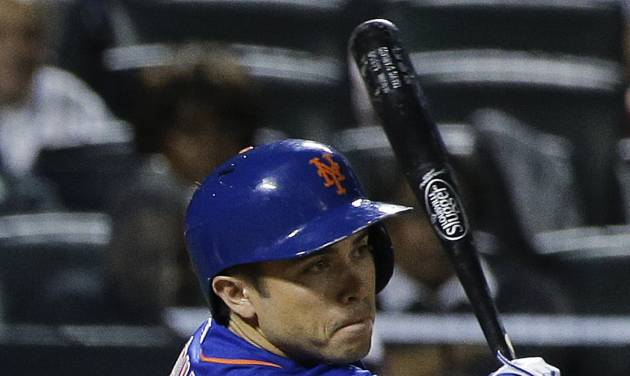 New York Mets catcher Travis d'Arnaud follows through on a double to center field, allowing Bobby Abreu and Eric Campbell to score, in the eighth inning of a baseball game against the Texas Rangers, Friday, July 4, 2014, in New York. (AP Photo/Julie Jacobson)