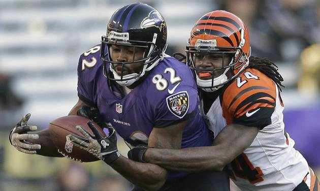 Cincinnati Bengals cornerback Adam Jones, right, breaks up a pass intended for Baltimore Ravens wide receiver Torrey Smith during the second half of an NFL football game in Baltimore, Sunday, Nov. 10, 2013. (AP Photo/Patrick Semansky)