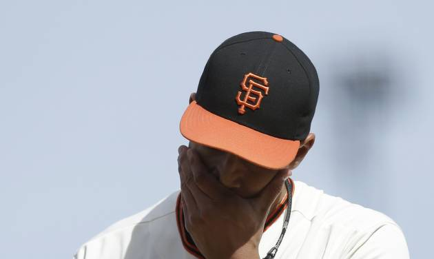 San Francisco Giants pitcher Javier Lopez walks off the mound during the eighth inning of a baseball game against the Colorado Rockies in San Francisco, Sunday, June 15, 2014. The Rockies won 8-7. (AP Photo/Jeff Chiu)