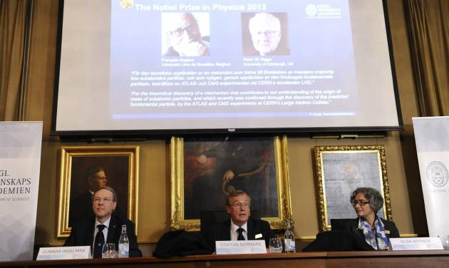 Chairman Gunnar Ingelman, left, permanent secretary Staffan Normark, center, and board member Olga Botner of the Royal Swedish Academy of Sciences announce the 2013 Nobel Prize in Physics is awarded to British physicist Peter Higgs and Belgian theoretical physicist Francois Englert during a press conference at the Royal Swedish Academy of Sciences in Stockholm, Sweden, Tuesday Oct. 8, 2013. (AP Photo/Erik Martensson, TT News Agency) SWEDEN OUT