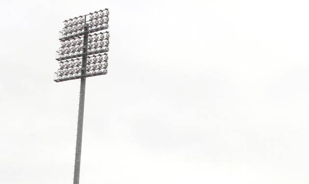 The stadium light near gate 6 on the southeast corner of the football stadium at Texas Tech University has been reported to have structural problems Thursday, May 2, 2013. The area around the light pole has been evacuated. (AP Photo/Lubbock Avalanche-Journal, Stephen Spillman)