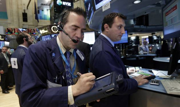 Trader Gregory Rowe, left, works on the floor of the New York Stock Exchange Tuesday, May 27, 2014. Stocks rose Tuesday after the government reported that orders for big-ticket items rose unexpectedly last month. (AP Photo/Richard Drew)