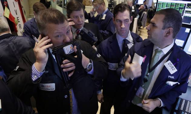 FILE - In this Tuesday, Jan. 14, 2014 file photo, traders gather at a post on the floor of the New York Stock Exchange. World stock markets struggled on Thursday Jan. 16, 2014 as they fought to scrape out more gains a day after a key U.S. benchmark climbed to a new high on strong earnings and economic data.  (AP Photo/Richard Drew)