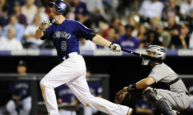 Colorado Rockies DJ LeMahieu hits a double in the third inning of a baseball game against the San Diego Padres on Monday, Aug. 12, 2013, in Denver. (AP Photo/Chris Schneider)