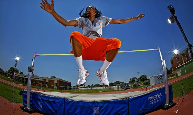 Oklahoma State women's basketball player Toni Young poses for a photo at the high-jump bar in Stillwater, Okla. Monday, June 25, 2012. Young qualified for the U.S. Olympic track and field trials after deciding on a whim to give the high-jump a try.  Photo by Chris Landsberger, The Oklahoman