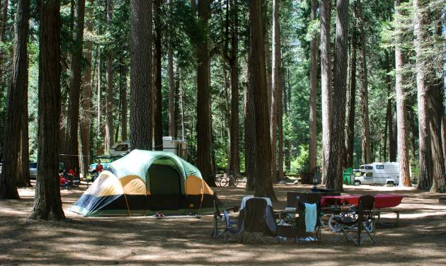 This undated image provided by the National Park Service shows tents pitched at a campground at Yosemite National Park in California. The thought of camping out can be daunting, but packing a few strategically chosen items like an inflatable mattress and food that's easy to grill can reduce the ick factor. (AP Photo/National Park Service)