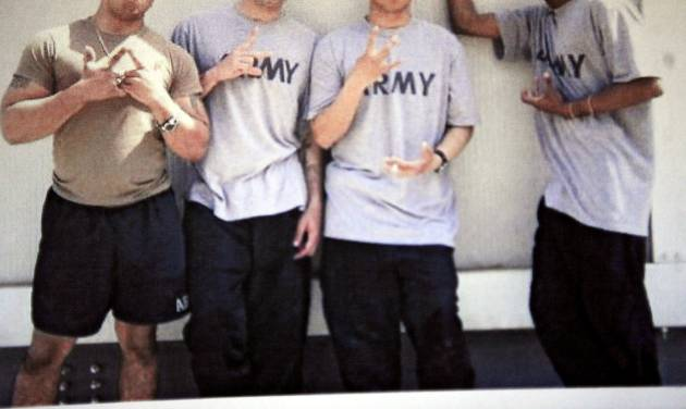Men identified by Lawton police as Fort Sill soldiers flash gang signs in a photo from a social networking Web site. PHOTO Provided by Lawton Police