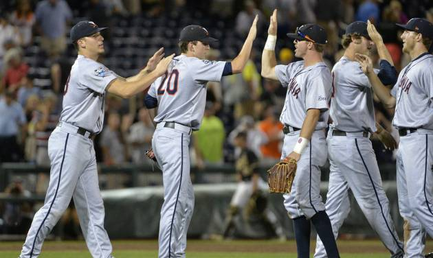 Virginia pitcher Brandon Waddell (20) celebrates with his teammates after Virginia defeated Vanderbilt 7-2 in Game 2 of the best-of-three NCAA baseball College World Series finals in Omaha, Neb., Tuesday, June 24, 2014. (AP Photo/Ted Kirk)