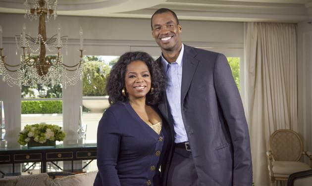 """This May 1, 2013 photo released by OWN shows host Oprah Winfrey posing with NBA  basketball player Jason Collins during an interview for """"Oprah's Next Chapter,"""" in Beverly Hills, Calif.  The interview aired Sunday. Officials at three publishing houses said Monday, May 6, that they had been contacted about a planned memoir by Collins, the first active player in any of four major U.S. professional sports leagues to come out as gay.  (AP Photo/OWN, Chuck Hodes)"""
