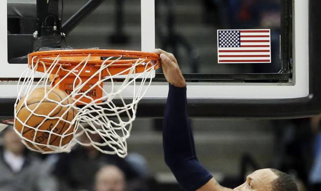 Dallas Mavericks' Shawn Marion slams in two points in the first quarter of an NBA basketball game against the Minnesota Timberwolves, Monday, Dec. 30, 2013, in Minneapolis. (AP Photo/Jim Mone)