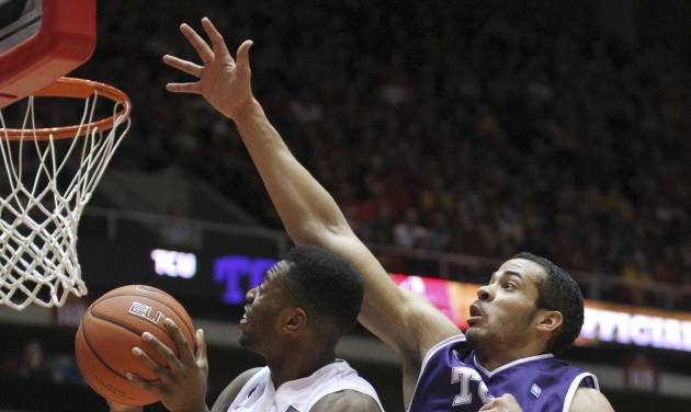 Iowa State forward Melvin Ejim (3) goes around TCU forward Amric Fields (4) as he goes up for a shot during the first half of an NCAA college basketball game at Hilton Coliseum in Ames, Iowa, Saturday, Feb. 8, 2014. (AP Photo/Justin Hayworth)