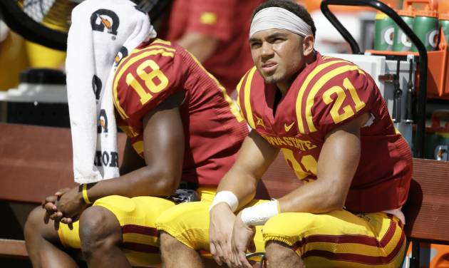 Iowa State wide receiver Orion Salters (21) and teammate Jauan Wesley (18) sit in the bench during the second half of an NCAA college football game against North Dakota State, Saturday, Aug. 30, 2014, in Ames, Iowa. North Dakota State won 34-14. (AP Photo/Charlie Neibergall)