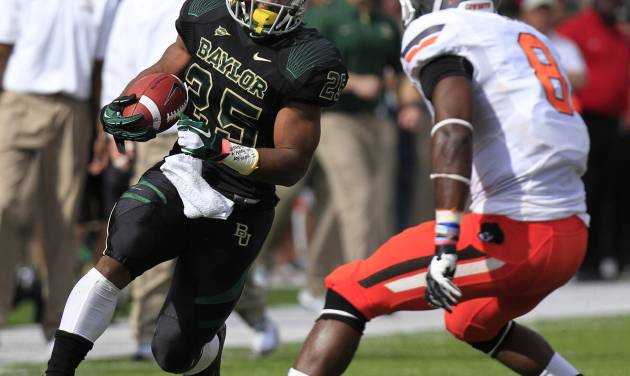 Baylor running back Lache Seastrunk (25) runs against Oklahoma State safety Daytawion Lowe (8) during the first half of an NCAA college football game, Saturday, Dec. 1, 2012, in Waco, Texas. (AP Photo/LM Otero)
