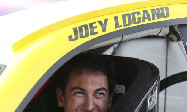 Joey Logano smiles after qualifying for the NASCAR Sprint Cup Series auto race at Michigan International Speedway in Brooklyn, Mich., Friday, Aug. 16, 2013. Logano won the pole. (AP Photo/Bob Brodbeck)