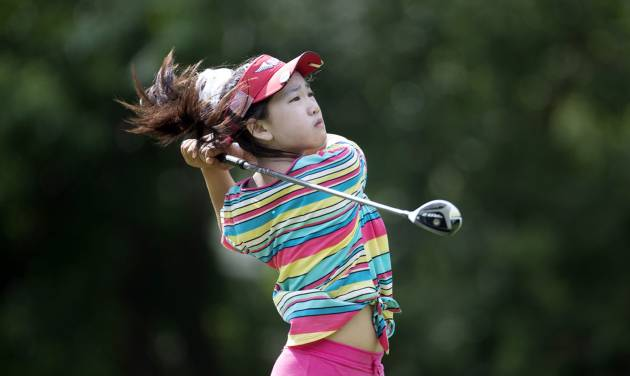 ADVANCE FOR WEEKEND EDITIONS JUNE 14-15 - FILE - This June 19, 2013 file photo provided by the USGA shows Lucy Li hitting a tee shot on the sixth hole during the first round of the 2013 U.S. Women's Public Links golf event in Norman, Okla. Li, the 11-year-old from the suburbs south of San Francisco became the youngest player to qualify for the U.S. Women's Open by winning the sectional at Half Moon Bay in California by seven strokes last month.  (AP Photo/USGA, Joel Kowsky, file)