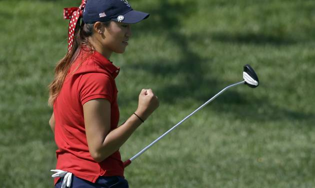 United States' Annie Park celebrates after putting in on the fifth hole during the 38th Curtis Cup amateur golf match against Great Britain and Ireland Friday, June 6, 2014, in St. Louis. (AP Photo/Jeff Roberson)