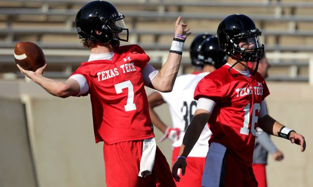 In this photo from Aug. 3, 2013, Texas Tech's Davis Webb(7) and Michael Brewer(16) throw passes during their NCAA college football practice in Lubbock, Texas. (AP Photo/Lubbock Avalanche-Journal, Stephen Spillman)